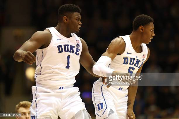 Teammates Zion Williamson and RJ Barrett of the Duke Blue Devils react after a play against the Army Black Knights during their game at Cameron...