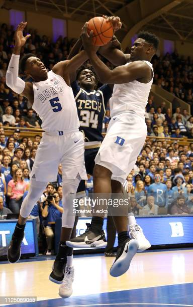 Teammates Zion Williamson and RJ Barrett of the Duke Blue Devils battle for a loose ball against Abdoulaye Gueye of the Georgia Tech Yellow Jackets...