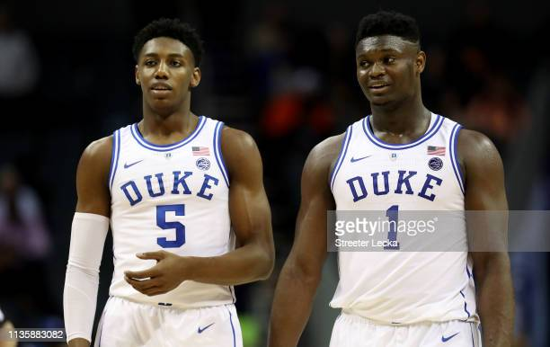 Teammates Zion Williamson and RJ Barrett of the Duke Blue Devils react against the Syracuse Orange during their game in the quarterfinal round of the...