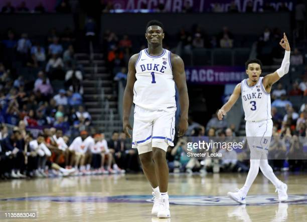 Teammates Zion Williamson and Tre Jones of the Duke Blue Devils react after defeating the Syracuse Orange 84-72 during their game in the quarterfinal...
