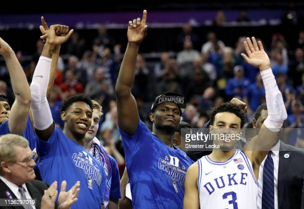 Teammates Zion Williamson RJ Barrett and Tre Jones of the Duke Blue Devils react after defeating the Florida State Seminoles 7363 in the championship...
