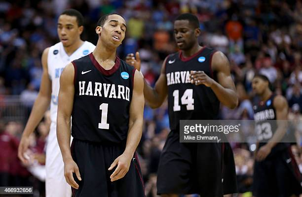 Teammatex Siyani Chambers and Steve Moundou-Missi of the Harvard Crimson react against the North Carolina Tar Heels during the second round of the...
