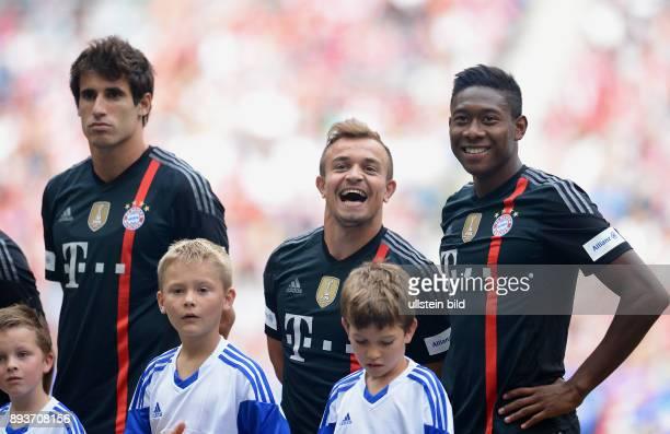 FUSSBALL 1 BUNDESLIGA SAISON 2014/2015 Teampraesentation / Training FC Bayern Muenchen in der Allianz Arena Javi Martinez Xherdan Shaqiri und David...