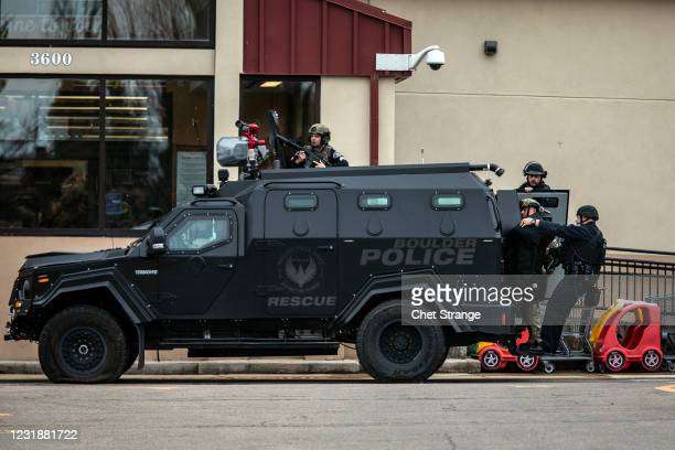 Teams advance through a parking lot as a gunman opened fire at a King Sooper's grocery store on March 22, 2021 in Boulder, Colorado. Ten people,...