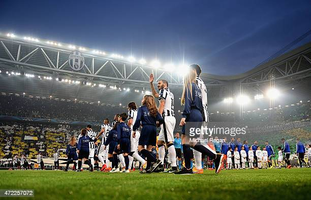 Teams and player escors walk on to the pitch prior to the UEFA Champions League semi final first leg match between Juventus and Real Madrid CF at...