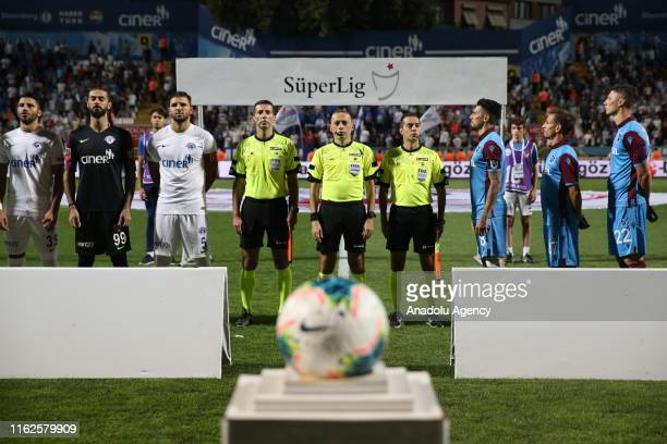 Teams and referees are seen during the anthem ceremony ahead of the Turkish Super Lig soccer match between Kasimpasa and Trabzonspor at Recep Tayyip...