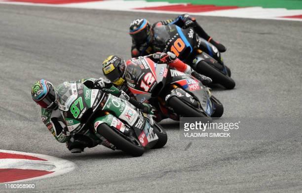 Team's Australian rider Remy Gardner, Dynavolt Intact's Swiss rider Thomas Luthi and SKY Racing Team VR46's Italian rider Luca Marini ride their...