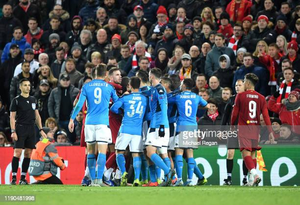 Teams clash during the UEFA Champions League group E match between Liverpool FC and SSC Napoli at Anfield on November 27 2019 in Liverpool United...