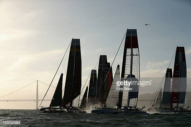 Teams compete in a fleet race during the America's Cup World Series on October 4, 2012 in San Francisco, California. Teams are racing on an AC45...