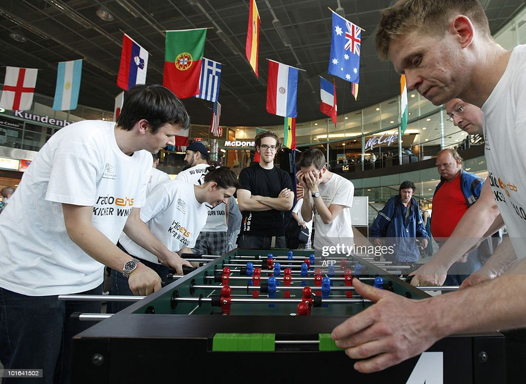 Teams compete in a tabletop football tournament on June 5, 2010 in Berlin as the start of the FIFA 2010 World Cup in South Africa draws near. During the competition organised by a Berlin radio chain, 64 listeners of the chain formed 32 teams representing the countries which will take part in the World Cup.