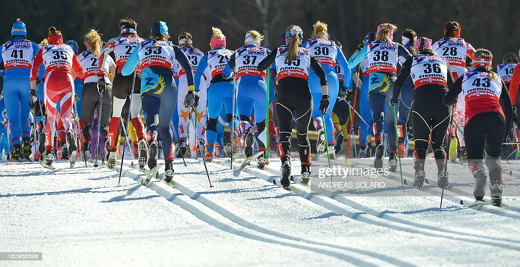 Teams compete on March 2, 2013 during the Women's Cross Country 30 km Classic race of the FIS Nordic World Ski Championships at Val Di Fiemme Cross Country stadium in Cavalese, northern Italy.