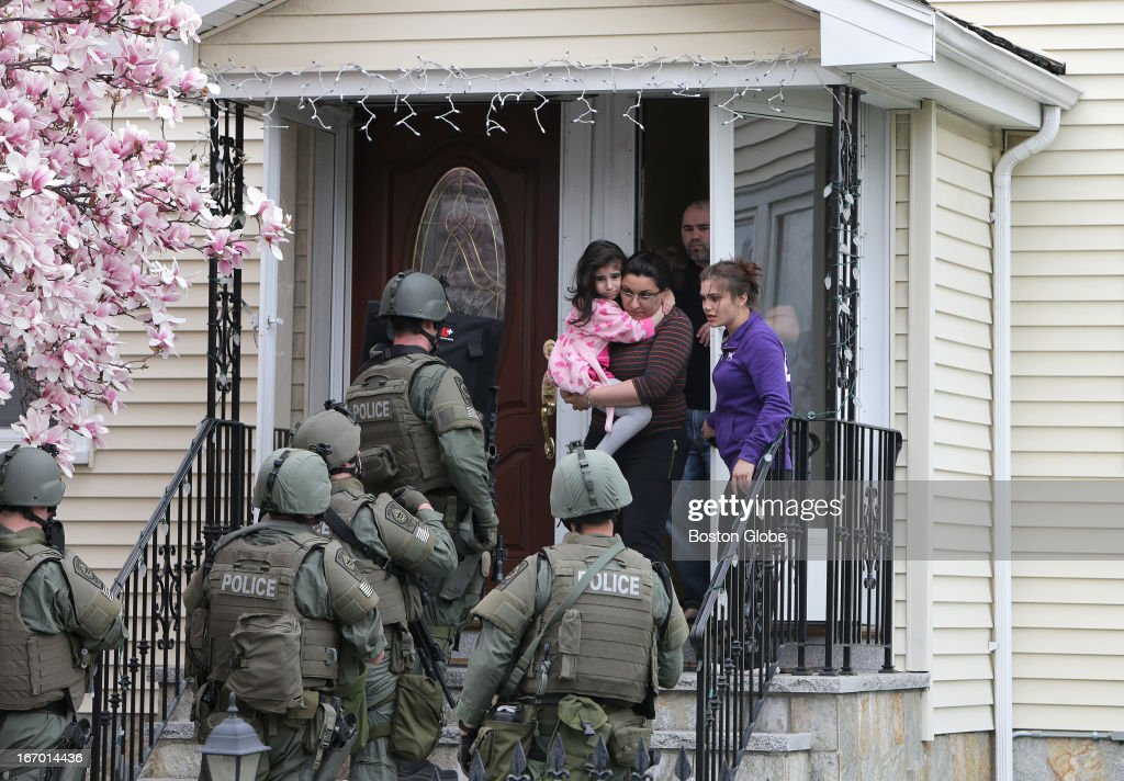 T. teams conduct a house to house search in an area near last night's shootout during the ongoing manhunt for a suspect in the terrorist bombing of the 117th Boston Marathon earlier this week.