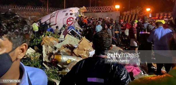 Teams conduct search and rescue operation at the site after an Air India Express passenger plane with 191 passengers onboard skidded off the runway...