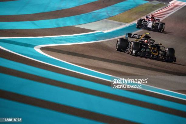 Team's Danish driver Kevin Magnussen steers his car at the Yas Marina Circuit in Abu Dhabi, during the final race of the Formula One Grand Prix...