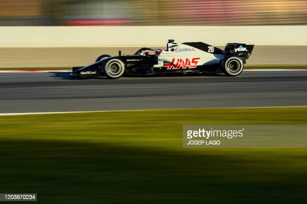 Team's Danish driver Kevin Magnussen takes part in the tests for the new Formula One Grand Prix season at the Circuit de Catalunya in Montmelo in the...