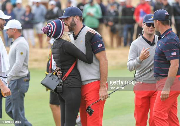 Team's Dustin Johnson kisses his partner Paulina Gretzky after the third round foursome matches at the Presidents Cup at The Royal Melbourne Golf...