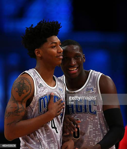 S Team's Elfrid Payton of the Orlando Magic reacts with US Team's Victor Oladipo of the Orlando Magic during the BBVA Compass Rising Stars Challenge...