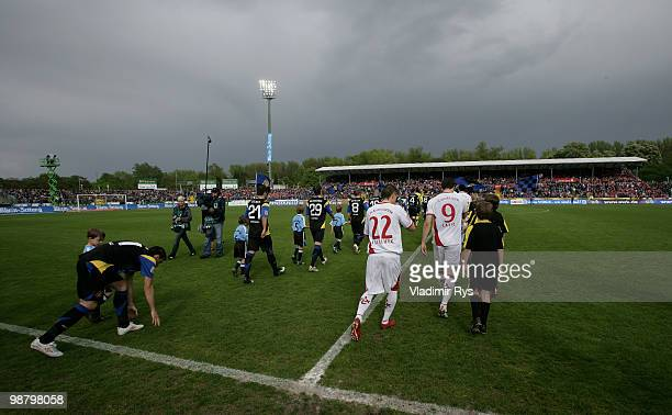 Teams enter the pitch prior the Second Bundesliga match between TuS Koblenz and 1 FC Kaiserslautern at Oberwerth Stadium on May 2 2010 in Koblenz am...
