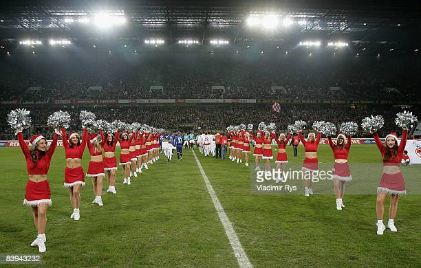 Teams enter the pitch prior to the Bundesliga match between 1 FC Koeln and Hamburger SV at the RheinEnergie stadium on December 07 2008 in Cologne...