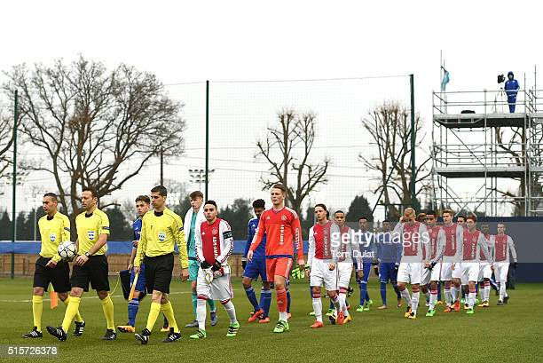 Teams enter the pitch prior to the UEFA Youth League quarter final match between Chelsea and Ajax at Chelsea Training Ground on March 15 2016 in...
