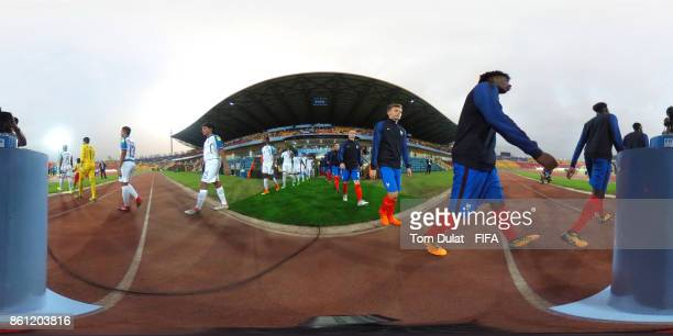 Teams enterthe pitch prior to the FIFA U17 World Cup India 2017 group E match between France and Honduras at Indira Gandhi Athletic Stadium on...