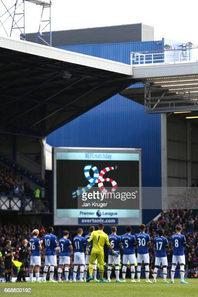 Teams fans and officals take part in a minute of applause on the 28th year anniversary of Hillsborough disaster prior toduring the Premier League...
