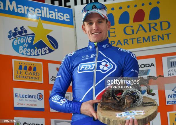 FDJ team's French cyclist Arnaud Demare poses with the trophy on the podium after winning the fourth stage during the 47th edition of the Etoile de...