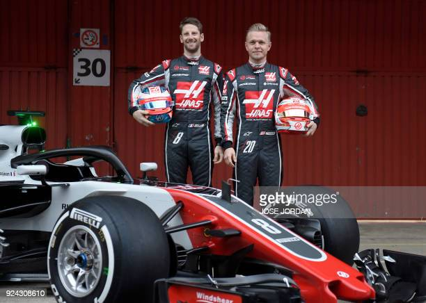 Team's French driver Romain Grosjean and HAAS F1 Team's Danish driver Kevin Magnussen pose by their new VF18 car during their official presentation...