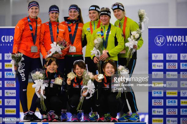 Teams from the Netherlands Japan and Germany stand on the podium after the ladies team pursuit during the ISU World Cup Short Track Speed Skating...