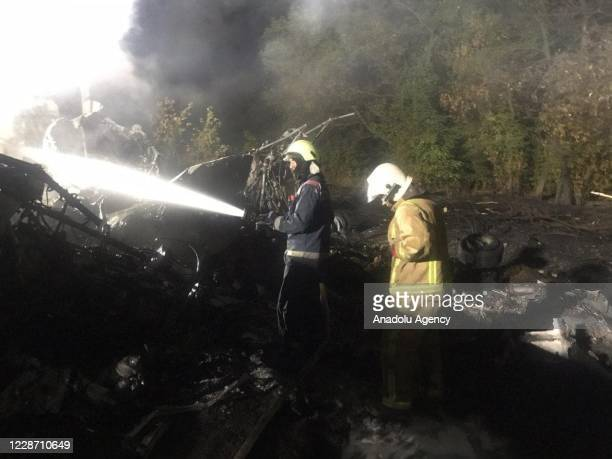 Teams from the State Emergency Service of Ukraine continue to work at the site after a military plane crash, killing 22 people, in Kharkiv, Ukraine...