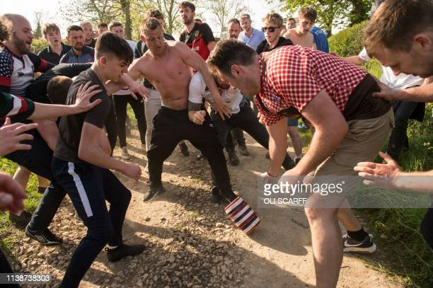 Teams from the villages of Hallaton and Medbourne fight over the 'bottles' during the Easter Monday Hallaton Hare Pie Scrambling and Bottle Kicking...