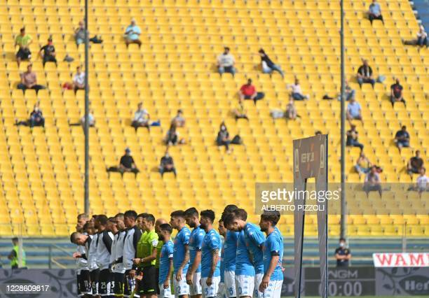 Teams line up as spectators sit in a tribune prior to the Italian Serie A football match Parma vs Napoli on September 20 2020 at the EnnioTardini...