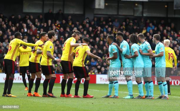 Teams line up during the Premier League match between Watford and AFC Bournemouth at Vicarage Road on March 31 2018 in Watford England