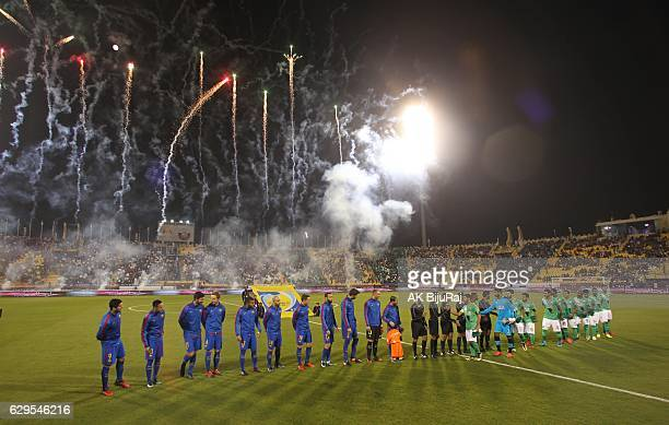 Teams line up during the Qatar Airways Cup match between FC Barcelona and Al-Ahli Saudi FC on December 13, 2016 in Doha, Qatar.