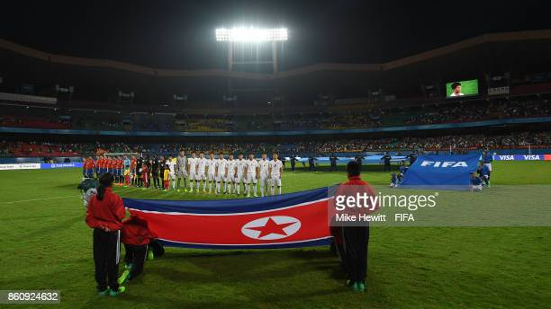 Teams line up for the National Anthems ahead of the FIFA U17 World Cup India 2017 group D match between Spain and Korea DPR at the Jawaharlal Nehru...