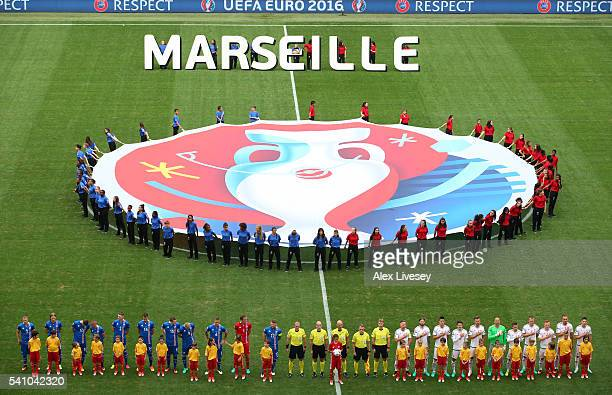teams line up for the national anthems during the UEFA EURO 2016 Group F match between Iceland and Hungary at Stade Velodrome on June 18 2016 in...