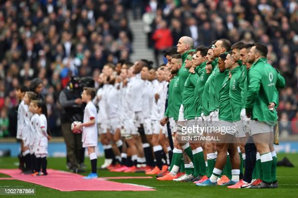 Teams line up for the National Athems before the Six Nations international rugby union match between England and Ireland at the Twickenham west...