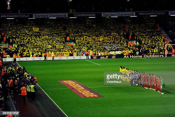 Teams line up in front of the Young Boys fans before the UEFA Europa League Group A match between Liverpool and BSC Young Boys at Anfield in...