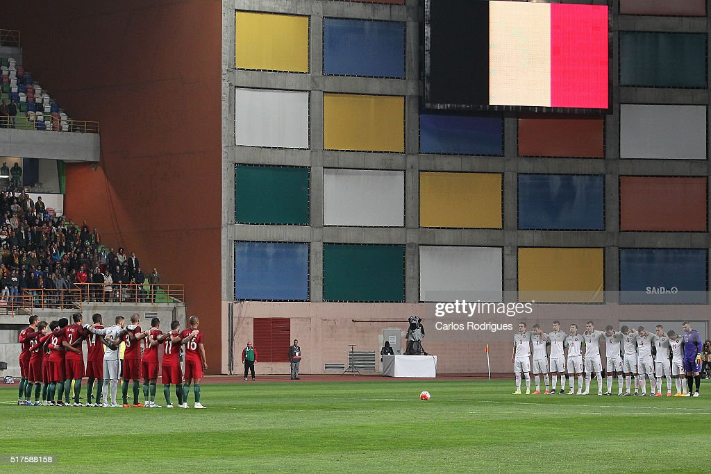 Teams line up to pay respect to the victims of the Brussels terror attacks during the match between Portugal and Bulgaria Friendly International at Estadio Municipal de Leiria on March 25, 2016 in Lisbon, Portugal.