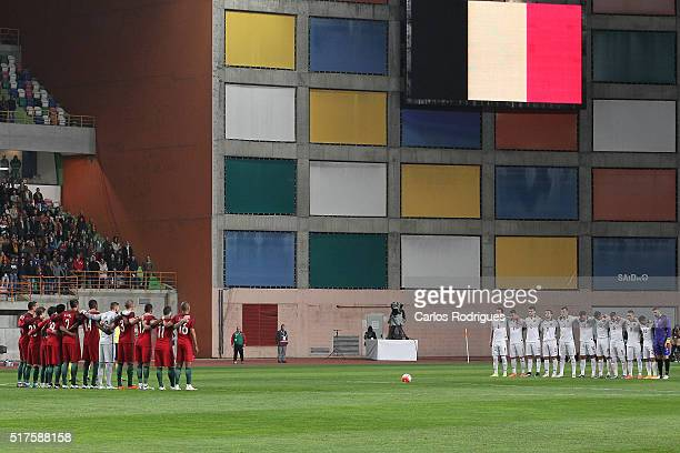 Teams line up to pay respect to the victims of the Brussels terror attacks during the match between Portugal and Bulgaria Friendly International at...