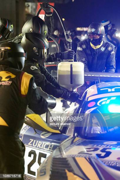 Teams Marc VDS's BMW Z4 with drivers Maxime Martin Lucas Luhr Marcus Palttala and Richard Westbrook stand in the pit stop for maintenance on the...