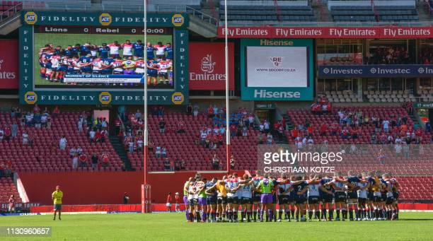 Teams observe a moment of silence for the terror attack victims in Christchurch New Zealand during the Super Rugby match between Emirates Lions and...
