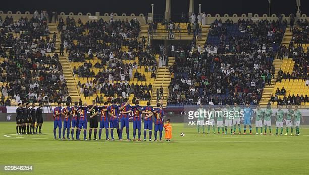 Teams observe one minute of silence during the Qatar Airways Cup match between FC Barcelona and Al-Ahli Saudi FC on December 13, 2016 in Doha, Qatar.