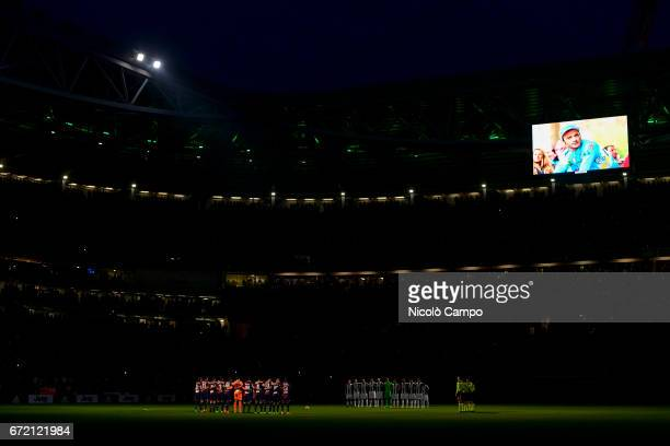 Teams of Juventus FC and Genoa CFC observe a minute of silence for the cyclist Michele Scarponi who died in an accident prior to the Serie A football...