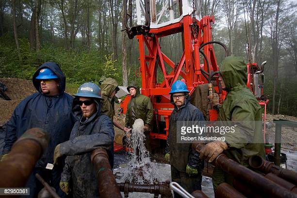 Teams of men from Minard Run Oil Company and Superior Well Services wait for pressure to subside during a fracing operation at a recently drilled...