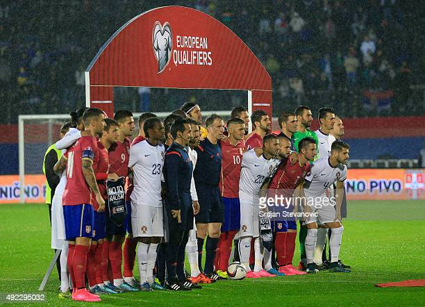 Teams of Serbia and Portugal pose together for the group photo prior the Euro 2016 qualifying football match between Serbia and Portugal at the...