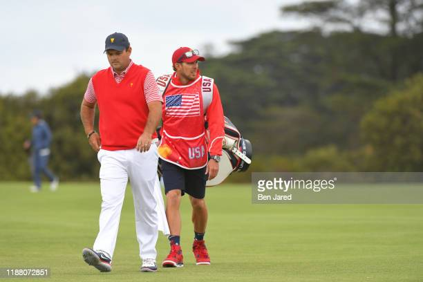 Teams Patrick Reed and Caddie Kessler Karain during the first round four-ball matches of the Presidents Cup at The Royal Melbourne Golf Club on...
