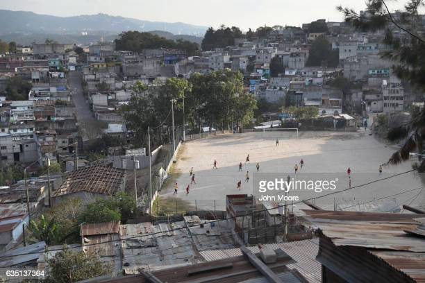 Teams play soccer on a hillside of the capital city's Zone 18, infamous in Guatemala for gang-related crime, on February 10, 2017 in Guatemala City,...