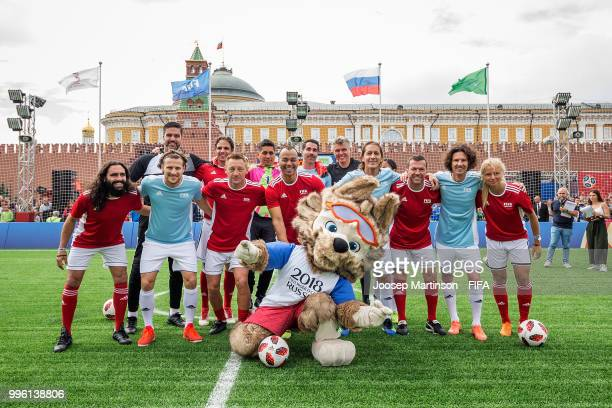 Teams pose during the Legends Football Match in Red Square on July 11 2018 in Moscow Russia