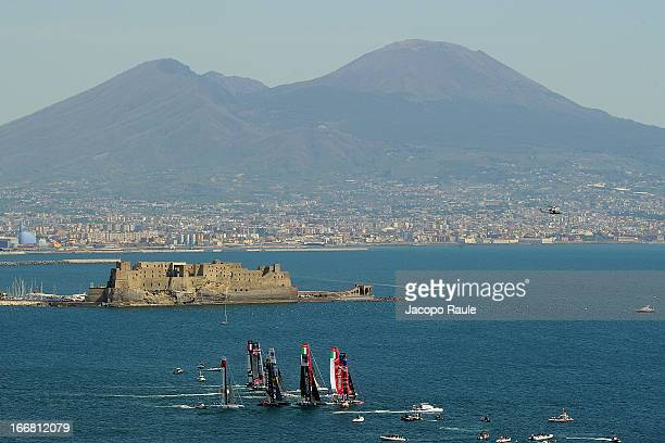 Teams sail in front of Mount Vesuvius during a practice race of America's Cup World Series Naples on April 17 2013 in Naples Italy